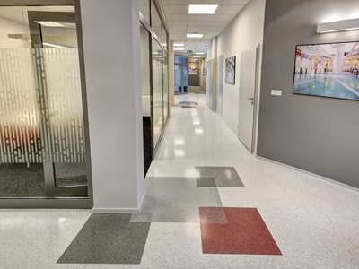 Detail of office corridor featuring resin flooring