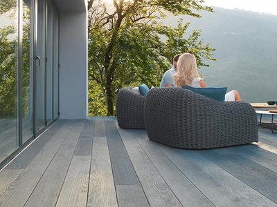 Outdoor decking with brushed basalt composite decking