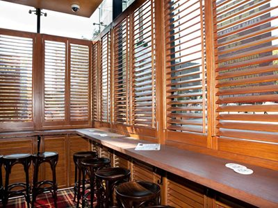 Bar interior with timber shutters