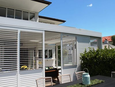 Exterior House View With LouvreTec White Shutters