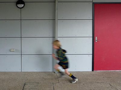 Child running past plaspanel exterior cladding