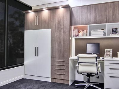 Residential interior with custom made desk and retractable desk