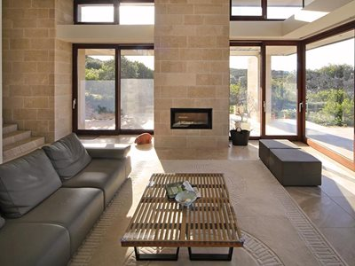 Rhodes Architectural Peninsula Amande limestone chimney feature in living room