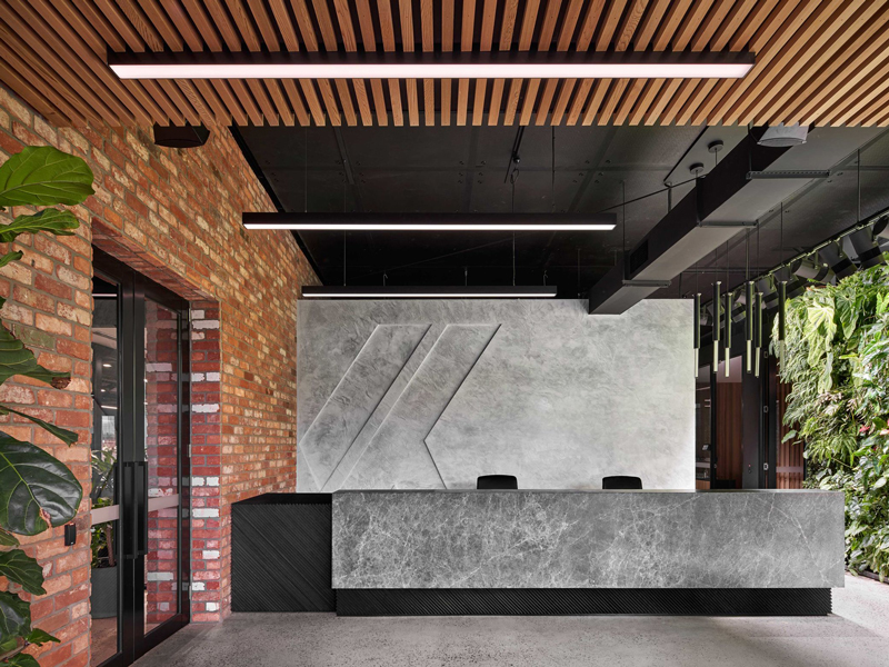 civilex office fitout brick concrete green wall timber