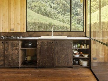 The open plan kitchen featuring recycled sheet metal furniture
