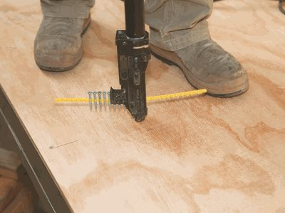 construction worker nailing ecoply plyfloor
