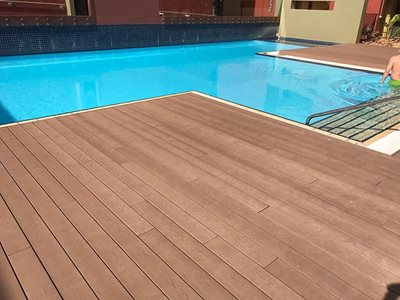 Detailed image of outdoor pool decking with wood composite board