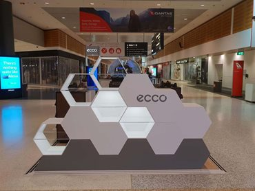 The retail displays feature a white honeycomb structure spliced on a timber base,