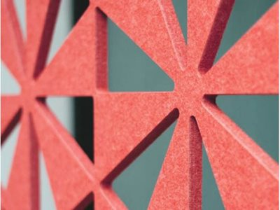 red pattern cut out acoustic paneling