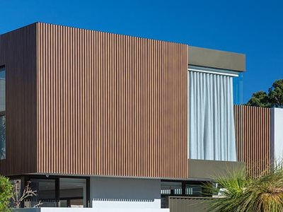 Building facade with aluminium batten cladding