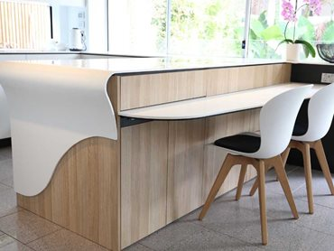 The curved edge quasi waterfall style gives an elegant touch to the kitchen bench