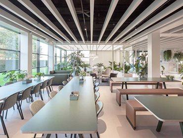 POLYLAM vertical baffles have been used in the ceilings of the entrance area, the meeting and training rooms, and the restaurant