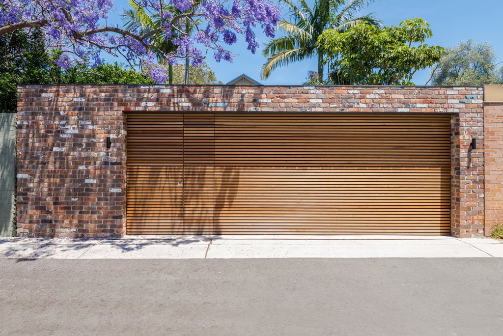 Recycled garage in sydney proves no project is too small for Cedar clad garage doors