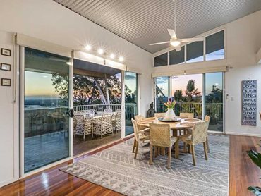 This two-level family home features wraparound balconies, all accessed through large sliding doors protected with Invisi-Gard screens