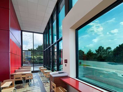Cafe interior with solar responsive thermochromic glazing clear day light