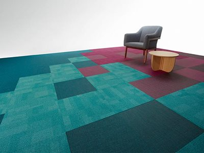 Interior view of pixel blue and maroon carpet tiles