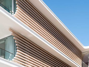 Ever Art Wood horizontal timber look battens cut and staggered at different lengths to create the crescent shaped feature screens