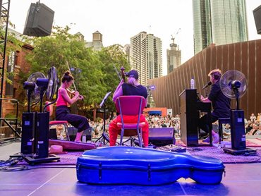 Eddie Perfect's introspective performance on a TITAN portable stage at the Malthouse Theatre Outdoor Stage