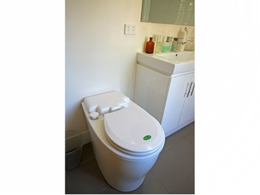 Waterless composting toilets by ECOFLO Water Management