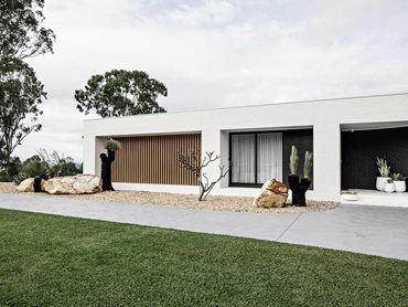 The striking vertical DecoBatten wall expands across the left side of the house