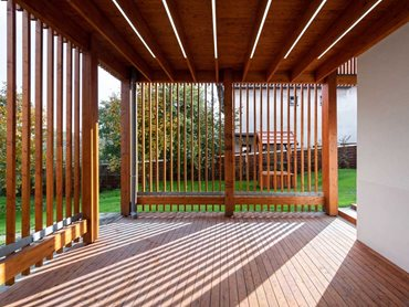 The slat structure sets up a pleasing pattern of light and shadow in the building