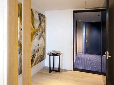 Internal View of Modern House Interior With Abstract Artwork and Timber Flooring