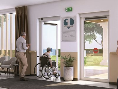 Interior entrance of elderly home with swing door system