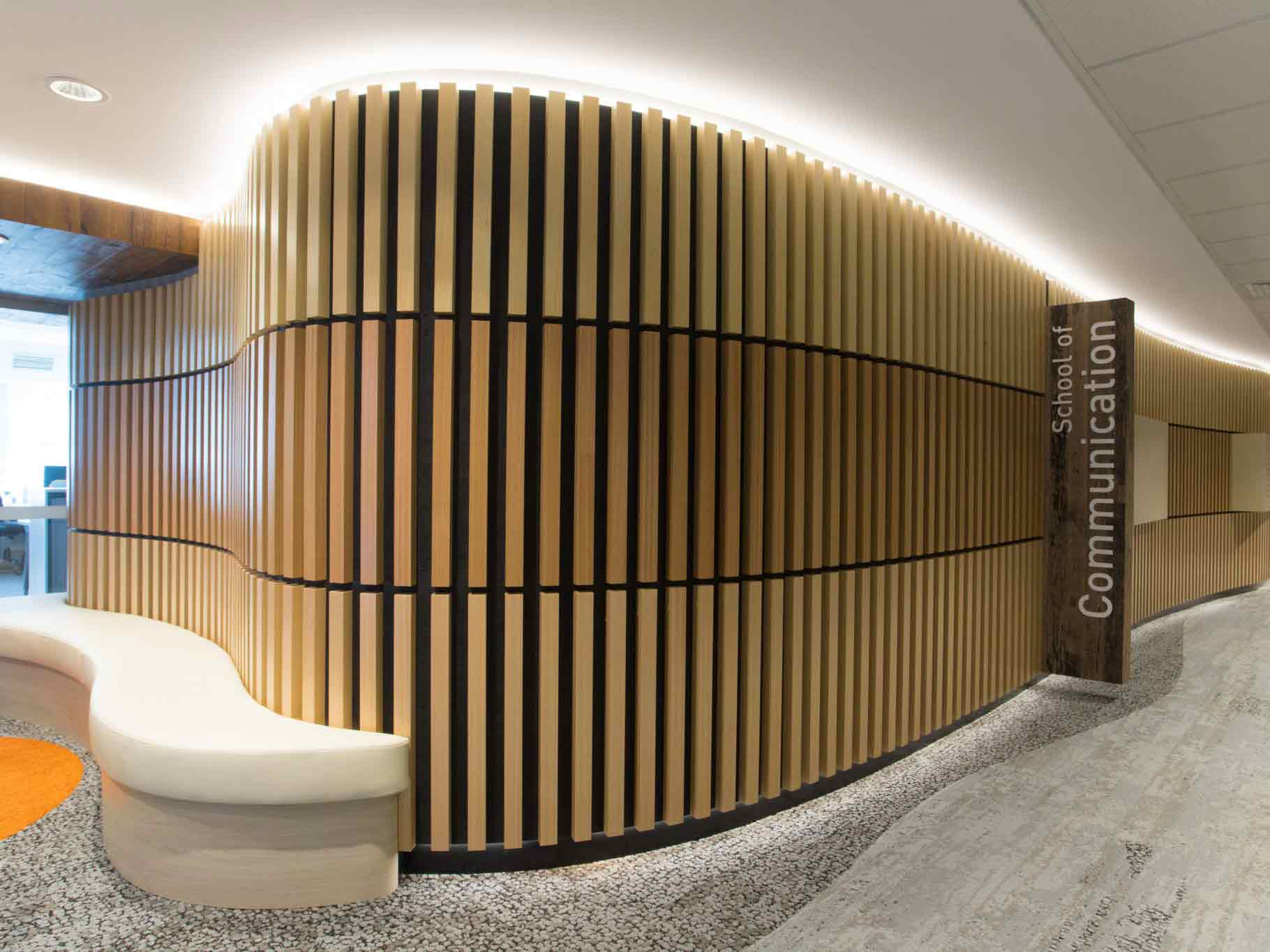 Reception area with slatted acoustic panels