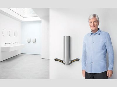 Dyson Airblade 9KJ James Dyson standing next to product in washroom