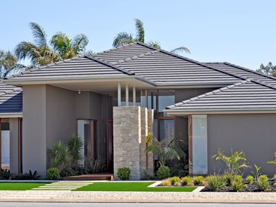 Exterior view of modern residential home with grey concrete roof tiles