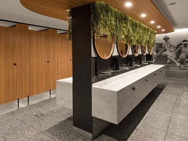 Westpoint Amenities features Corian® in Rain Cloud and Deep Titanium colours