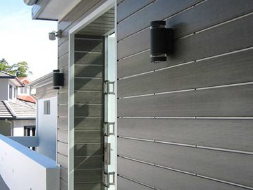 The flat joint concealed fixing system connects two boards together with aluminium clips to give a uniform 1mm shadow line between the cladding boards