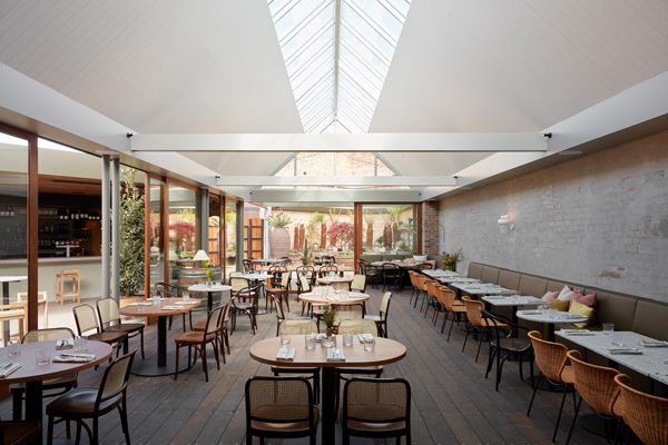 half acre restaurant adaptive reuse addition natural light