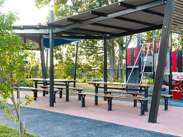 The playground furniture has been built with Street Furniture's aluminium Spotted Gum woodgrain battens paired with satin Monument frames