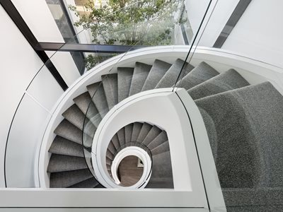 spiral staircase curved glass banister