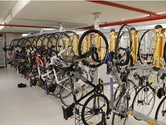 Vertical, wall and frame-mounted bicycle parking racks and hangers