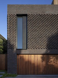 dark brick extruded pattern residentail house