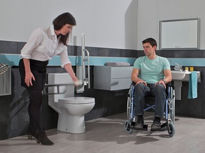 Accessible bathroom interior with adjustable arm rest hardware