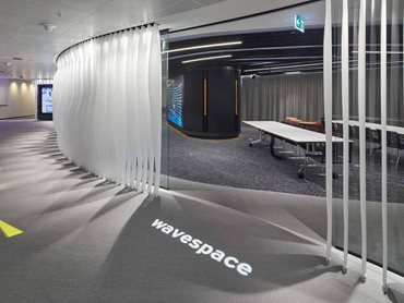 The floor to ceiling 'wave' subtly segregated two areas of the EY WaveSpace office