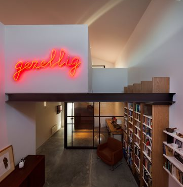 Passive Warehouse library and gezellig neon signage. Photography by Trevor Mein