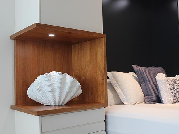 Custom built fold down wall bed with open display veneer open section close up shot