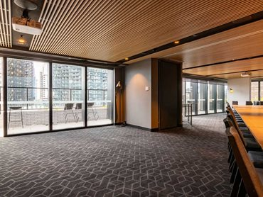 The geometric pattern is carried through to the conference rooms