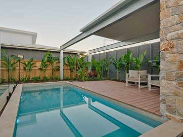 DecoDeck timber-look aluminium deck in the pool area