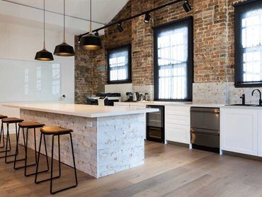The soft tones of the flooring were a perfect match for exposed raw elements such as brick