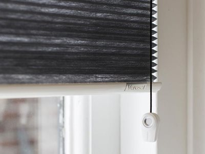 Detailed image of insulated pleated and cellular blinds