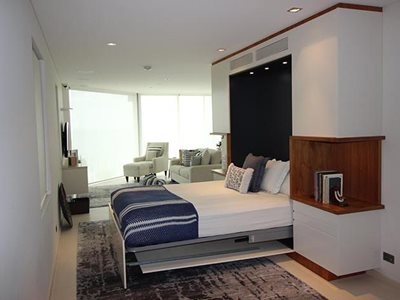 Custom built fold down wall bed with open display veneer cut outs open shot