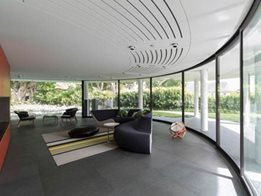 Residential interiors and exteriors from bent and curved glass