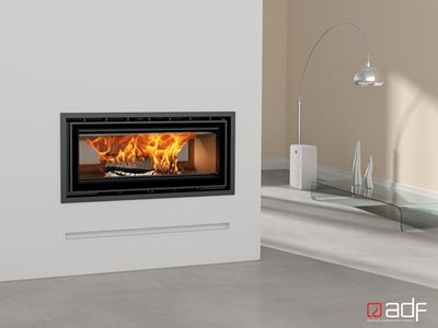 Modern recessed wall fireplace in home interior