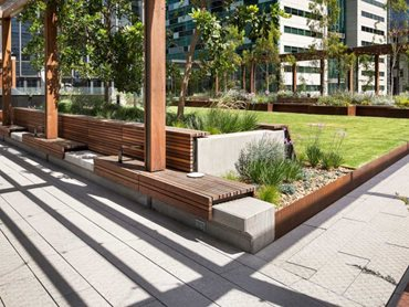 Custom exposed aggregate paving by Anston Architectural at Skypark, Melbourne Quarter