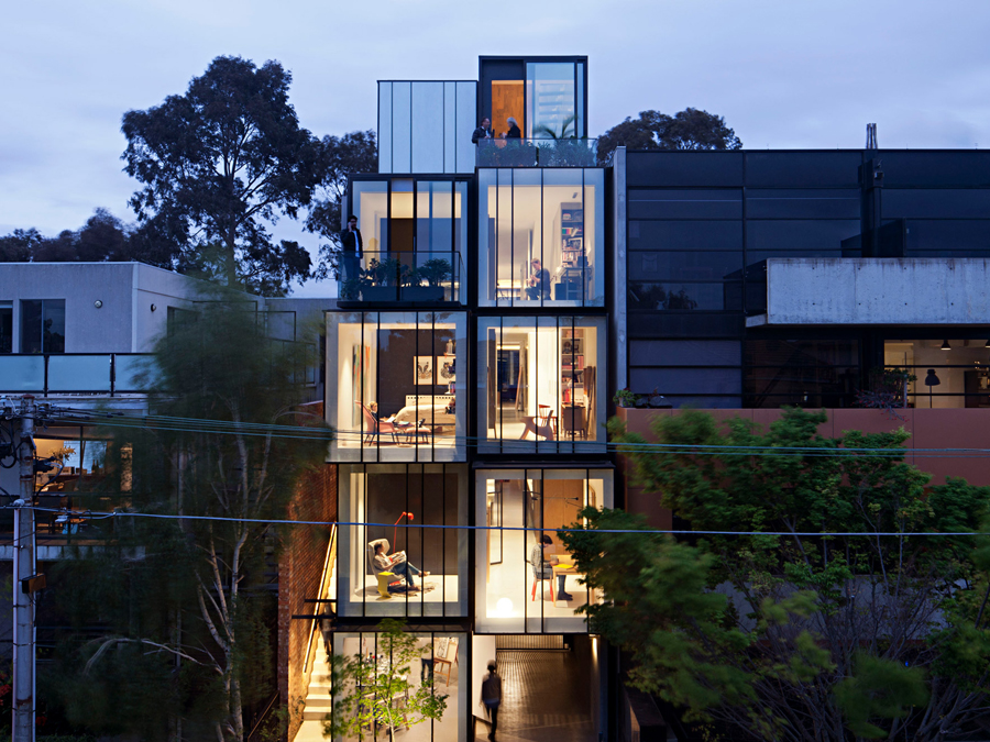 multi-generational mixed-use house exterior night